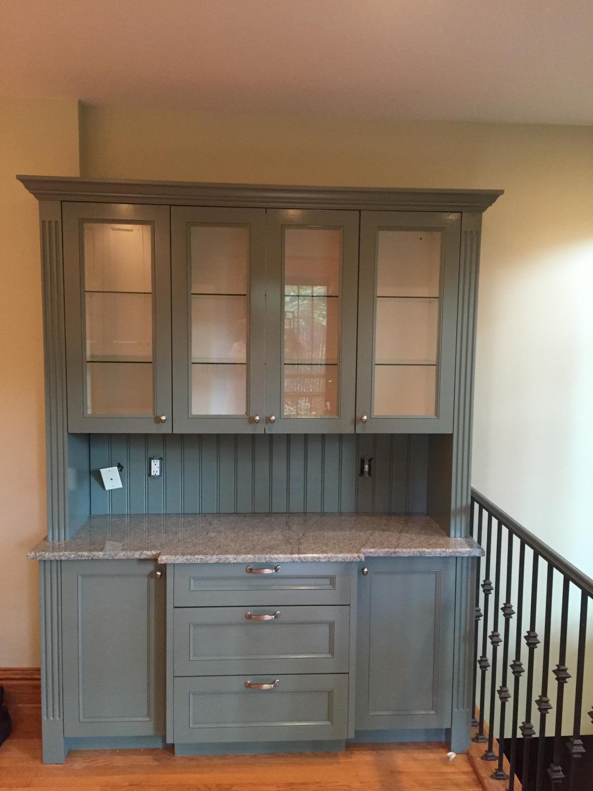 Repainted Cabinets · Refinished Woodwork